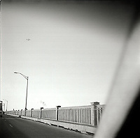 Side of road seen through windshield<br />