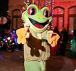 A frog from the Rain Forest Cafe float passes by  the Mardi Gras Ball at the Tremont House in Galveston Saturday Feb. 13,2010.(Dave Rossman Photo)