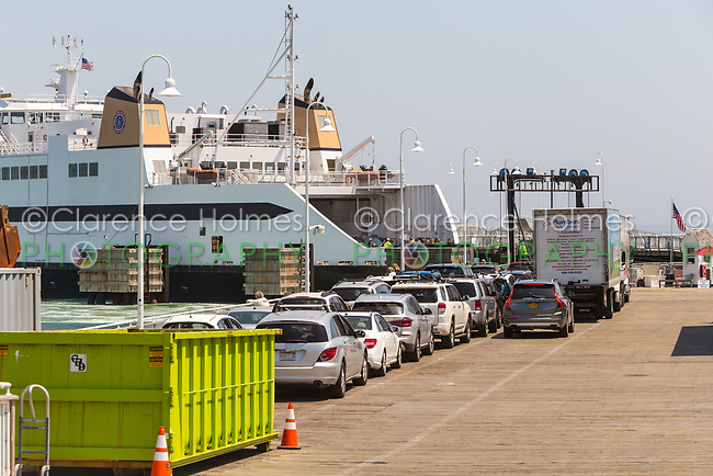 Vehicles wait in line to board a Steamship Authority ferry preparing to depart the ferry terminal in Oak Bluffs, Massachusetts on Martha's Vineyard.