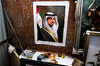 A painting of a Middle Eastern man wearing traditional dress on the wall of an artist's studio. As well as producing replicas, the town's artists take commissions from clients worldwide. Dafen is home to an art industry producing replicas, as well as original works, of pieces by the world's great artists for sale overseas. The success of this business has attracted more and more trained artists to the town seeking an opportunity to make a living.