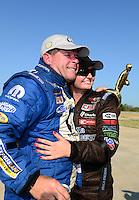 Sept. 23, 2012; Ennis, TX, USA: NHRA pro stock driver Allen Johnson celebrates after winning with runner-up Erica Enders the Fall Nationals at the Texas Motorplex. Mandatory Credit: Mark J. Rebilas-