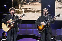"""Robert Charlebois and Francis Cabrel perform at the """"Paris-Quebec"""" show of the 44th Festival d'ete de Quebec on the Plains of Abraham in Quebec city Thursday July 7, 2011."""