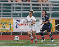 Boston Aztec defender Taleen Taylor (23) brings the ball forward.  In a Women's Premier Soccer League (WPSL) match, Boston Aztec (white) defeated Seacoast United Phantoms (blue), 3-0, at North Reading High School Stadium on Arthur J. Kenney Athletic Field on on June 25, 2013.