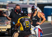 Sep 5, 2020; Clermont, Indiana, United States; NHRA factory stock driver Leah Pruett (right) and crew member argue with NHRA official during qualifying for the US Nationals at Lucas Oil Raceway. Mandatory Credit: Mark J. Rebilas-USA TODAY Sports
