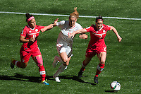 June 21, 2015: Rhian WILKINSON of Canada protects the ballduring a round of 16 match between Canada and Switzerland at the FIFA Women's World Cup Canada 2015 at BC Place Stadium on 21 June 2015 in Vancouver, Canada. Canada won 1-0. Sydney Low/Asteriskimages.com