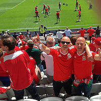 COPY BY TOM BEDFORD MEDIA<br /> Pictured: Matt Evans (C) with his dad Chris (R) in France to watch Wales play against England<br /> Re: Former postman, lotto Millionaire Matt Evans, 35, from Barry, south Wales, has been spending his winnings to watch Wales play in the UEFA European Championship in France.