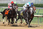 General Quarters with Alex Solis (white cap) pass the stands for the first time in The Stephen Foster Handicap at Churchill Downs. 06.12.2010