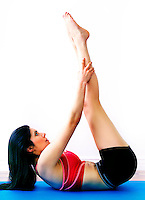 Beautiful female in her work out with arms forward as she stretches