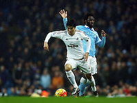 Wilfried Bony of Manchester City and Ki Sung-Yueng of Swansea City during the Barclays Premier League match between Manchester City and Swansea City played at the Etihad Stadium, Manchester on December 12th 2015