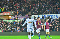 Pictured: Friday 26 December 2014<br /> Re: Premier League, Swansea City FC v Aston Villa at the Liberty Stadium, Swansea, south Wales, UK.<br /> <br /> Swansea's Wilfried Bony celebrates a goal that is disallowed