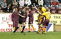 29/09/2007       Copyright Pic: James Stewart.File Name : sct_jspa05_motherwell_v_rangers.Nacho Novo sits in the stand (left) and watches as Motherwell's Chris Porter is congratulated after he scores the opener.....James Stewart Photo Agency 19 Carronlea Drive, Falkirk. FK2 8DN      Vat Reg No. 607 6932 25.Office     : +44 (0)1324 570906     .Mobile   : +44 (0)7721 416997.Fax         : +44 (0)1324 570906.E-mail  :  jim@jspa.co.uk.If you require further information then contact Jim Stewart on any of the numbers above........