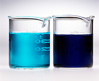 TRANSITION METAL COMPLEX SOLUTIONS<br /> (3 of 3)<br /> Adding Ammonia To Copper II Nitrate.(left) Solution of blue Cu(NO3)2*6H2O (complex ion is Cu(H2O)6 +2).(right) Addition of NH3(aq) forms deep blue complex ion [Cu(NH3)4(H2O)2]2+.