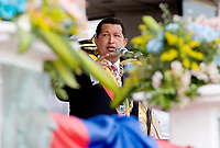 """Venezuelan president Hugo Chavez delivers a speech during a military parade in Valencia, Venezuela, on Saturday, June 24, 2006. The military parade was to celebrate Army Day and took place in """"Campo de Carabobo"""", the field where the last big battle for the Venezuelan independence was won. (ALTERPHOTOS/Alvaro Hernandez)."""