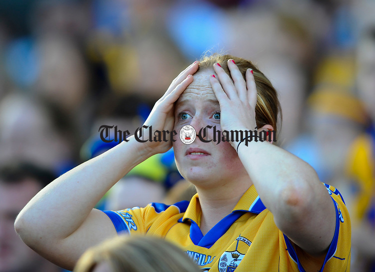 A Clare supporter looks on in agony moments before the final whistle during the Intermediate Ladies Football final at Croke Park. Photograph by John Kelly.