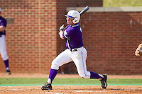 Dane McDermott (7) of the High Point Panthers follows through on his swing against the Coastal Carolina Chanticleers at Willard Stadium on March 15, 2014 in High Point, North Carolina.  The Chanticleers defeated the Panthers 1-0 in the first game of a double-header.  (Brian Westerholt/Four Seam Images)