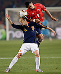 25.06.2010, Loftus Versfeld Stadium, Tshwane Pretoria, RSA, FIFA WM 2010, Chile (CHI) vs Spain (ESP)., im  Bild Andres Iniesta of Spain tangles with Arturo Vidal of Chile.  Foto: nph /    Marc Atkins