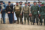 RE-ENACTORS WEAR MILITARY UNIFORMS BEGINNING from the AMERICAN REVOLUTION to the CURRENT DAY