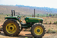 Malawi, Thyolo, Makandi Tea Estate, a fair trade tea plantation, John Deere Tractor, planting of new tea shrubs