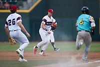Winston-Salem Rayados first baseman AJ Gill (7) races Trey Hair (6) of the Llamas de Hickory to first base at Truist Stadium on July 6, 2021 in Winston-Salem, North Carolina. (Brian Westerholt/Four Seam Images)