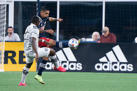 FOXBOROUGH, MA - JULY 25: A.J. DeLaGarza #28 of New England Revolution clears the ball near the New England Revolution during a game between CF Montreal and New England Revolution at Gillette Stadium on July 25, 2021 in Foxborough, Massachusetts.