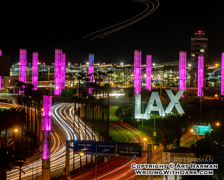 """LAX Airport in One Shot"" by Art Harman. Everything is here--the airplane overhead, the terminals, the signs, the control tower, and of course, the traffic. From a secret venue."