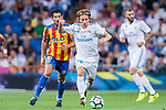Luka Modric (r) of Real Madrid battles for the ball with Daniel Parejo Munoz of Valencia CF during their La Liga 2017-18 match between Real Madrid and Valencia CF at the Estadio Santiago Bernabeu on 27 August 2017 in Madrid, Spain. Photo by Diego Gonzalez / Power Sport Images