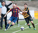 Alloa Manager Paul Hartley claims a foul as Livy's Martin Scott has a pull at Alloa's Kevin Cawley.