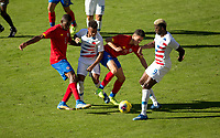 CARSON, CA - FEBRUARY 1: Keysher Fuller #4 and Cristopher Nunez #13 of Costa Rica battle with Brandon Servania #16 and Gyasi Zardes #9 of USA during a game between Costa Rica and USMNT at Dignity Health Sports Park on February 1, 2020 in Carson, California.