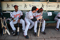 OAKLAND, CA - JUNE 6:  Melvin Mora #6 (left), Luke Scott #30 and Felix Pie #18 of the Baltimore Orioles joke around in the dugout before the game against the Oakland Athletics at the Oakland-Alameda County Coliseum on June 6, 2009 in Oakland, California. Photo by Brad Mangin