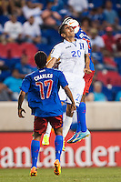 Honduras defender Jorge Claros (20) goes up for a header with Haiti midfielder Yves Hadley Desmarets (15). Honduras defeated Haiti 2-0 during a CONCACAF Gold Cup group B match at Red Bull Arena in Harrison, NJ, on July 8, 2013.