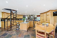 BNPS.co.uk (01202 558833)<br /> Pic: KnightFrank/BNPS<br /> <br /> Pictured: Kitchen.<br /> <br /> An impressive family home built in an 'industrial scale' oast house with multiple circular rooms is on the market for £1.6m.<br /> <br /> The property is one half of a massive former six roundel oast house that has been expanded and renovated by the current owners.<br /> <br /> Estate agents Knight Frank say the roundels are far larger than normally seen in most oast houses, which means the property has quirky character while also being a practical family home.<br /> <br /> This six-bedroom house is in the picturesque Kent countryside, but just 1.5 miles from the village of Hadlow and ten minutes' drive from the bigger town of Tonbridge.