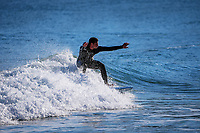 Surfing at Lyall Bay in Wellington, New Zealand on Saturday, 11 September 2021. Photo: Dave Lintott / lintottphoto.co.nz