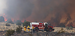 Firefighters battle a 150-acre fire near Holbrook Junction, Nev., on Saturday, Sept. 10, 2011. Dozens of homes were initially threatened but firefighters have caught the fire and an estimated 250 personnel are on scene..Photo by Cathleen Allison