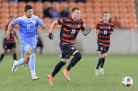 Houston, TX - Friday December 9, 2016: Corey Baird (10) of the Stanford Cardinal races for the goal with Mauricio Pineda (2) of the North Carolina Tar Heels in pursuit at the NCAA Men's Soccer Semifinals at BBVA Compass Stadium in Houston Texas.