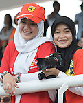 05 Apr 2009, Kuala Lumpur, Malaysia --- A couple of Muslim young girls Ferrari fans attend the 2009 Fia Formula One Malasyan Grand Prix at the Sepang circuit near Kuala Lumpur. Photo by Victor Fraile --- Image by © Victor Fraile / The Power of Sport Images