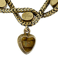 BNPS.co.uk (01202 558833)<br /> Pic: Fellows/BNPS<br /> <br /> Pictured: 'Alfred' engraved on the locket.<br /> <br /> A poignant bracelet that belonged to Queen Victoria and still contains a lock of her daughter's hair has sold for almost £4000.<br /> <br /> The extraordinary piece of jewellery has five lockets attached to it and each would have held strands of hair of her children at the time.<br /> <br /> She had the names of Princesses Victoria, Alice, Louise and Helena and Prince Alfred engraved on the bracelet.