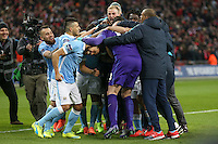 Manchester City congratulate Wilfredo Caballero of Manchester City following his saves in a penalty shoot out against Liverpool after the Capital One Cup match between Liverpool and Manchester City at Wembley Stadium, London, England on 28 February 2016. Photo by David Horn / PRiME Media Images.