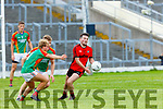 Peter Crowley and Fiachra Clifford  Mid Kerry swarm Michael McCArthy Kenmare during their SFC quarter final in Fitzgerald Stadium on Sunday