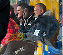 Caley assistant manager Russell Latapy and manager John Hughes watch from the dug out.