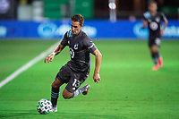 LAKE BUENA VISTA, FL - AUGUST 06: Ethan Finlay #13 of Minnesota United FC dribbles the ball during a game between Orlando City SC and Minnesota United FC at ESPN Wide World of Sports on August 06, 2020 in Lake Buena Vista, Florida.