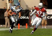 Nov. 6, 2005; Tempe, AZ, USA; Wide Receiver (87) Joe Jurevicius of the Seattle Seahawks tries to evade linebacker (57) Orlando Huff of the Arizona Cardinals at Sun Devil Stadium. Mandatory Credit: Mark J. Rebilas