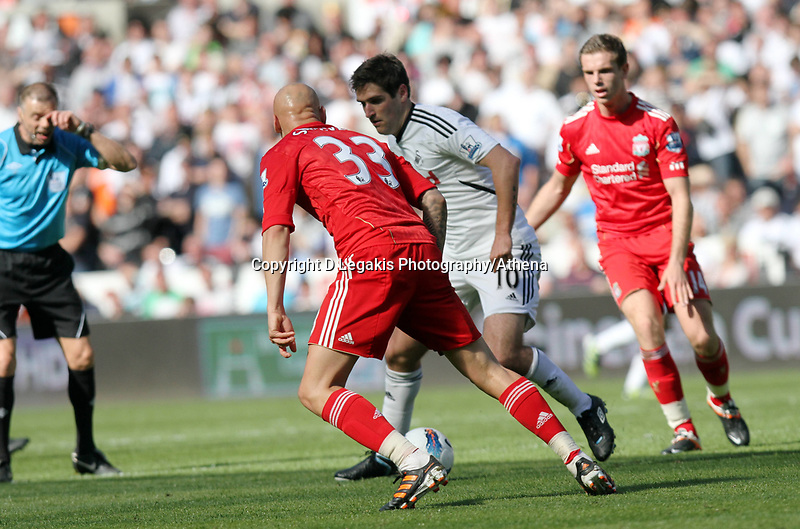 Barclay Premier League, Swansea City (white) V Liverpool (red) Liberty Stadium, 13/05/12<br /> Pictured: Danny Graham runs at Liverpool defender Jonjo Shelvey<br /> Picture by: Ben Wyeth / Athena <br /> info@athena-pictures.com