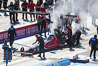 Nov 1, 2020; Las Vegas, Nevada, USA; A crew member guides NHRA top fuel driver Steve Torrence into the staging beams during the NHRA Finals at The Strip at Las Vegas Motor Speedway. Mandatory Credit: Mark J. Rebilas-USA TODAY Sports