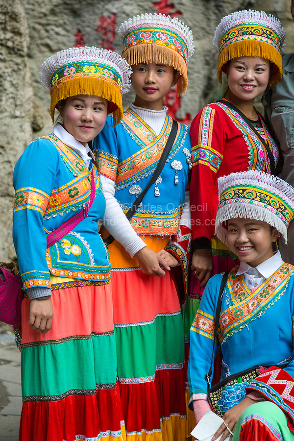 China, Guizhou, Dragon Palace Scenic Area.  Young Women in Traditional Bouyei Dress.