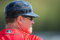 Kannapolis Intimidators manager Pete Rose Jr. (14) coaches third base during the South Atlantic League game against the Hickory Crawdads at CMC-Northeast Stadium on April 9, 2014 in Kannapolis, North Carolina.  The Intimidators defeated the Crawdads 1-0.  (Brian Westerholt/Four Seam Images)