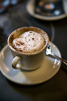 Cup of cappuccino in a cafe.