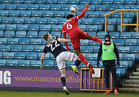 Loic Mbe Soh of Nottingham Forestand Jon Daoi Boovarsson of Millwall go for a header during Millwall vs Nottingham Forest, Sky Bet EFL Championship Football at The Den on 19th December 2020