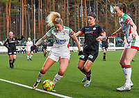 Tine Schryvers (23) of OHL pictured in a duel with Amber De Priester (6) of Zulte-Waregem and Sari Kees (2) of OHL  during a female soccer game between Oud Heverlee Leuven and SV Zulte-Waregem on the 16 th matchday of the 2020 - 2021 season of Belgian Womens Super League , sunday 14 th of March 2021  in Heverlee , Belgium . PHOTO SPORTPIX.BE | SPP | DAVID CATRY