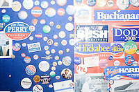 Campaign buttons and stickers from past years' presidential campaigns hang on a bulletin board of the New Hampshire State House visitor's center in Concord, New Hampshire.
