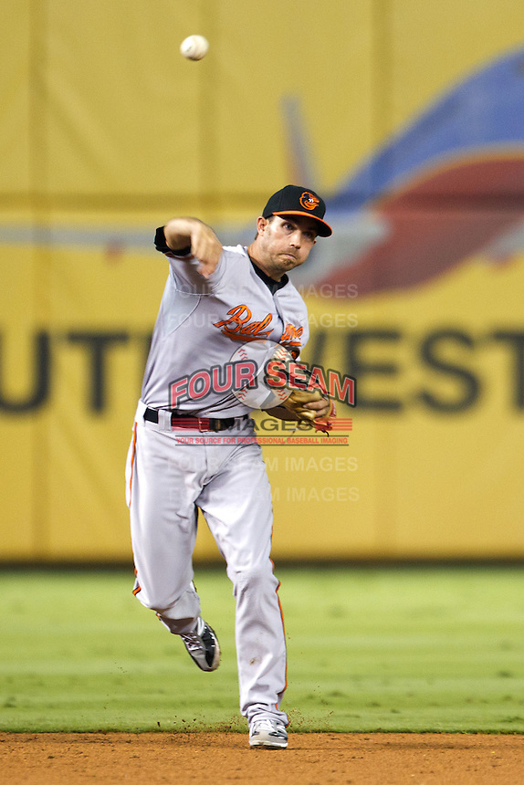 Baltimore Orioles shortstop JJ Hardy #2 throws to first during the Major League Baseball game against the Texas Rangers on August 21st, 2012 at the Rangers Ballpark in Arlington, Texas. The Orioles defeated the Rangers 5-3. (Andrew Woolley/Four Seam Images).
